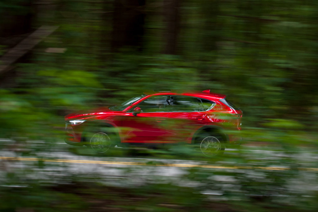 Soul Red 2018 Mazda CX-5 SKYACTIV driving through the woods automotive photography