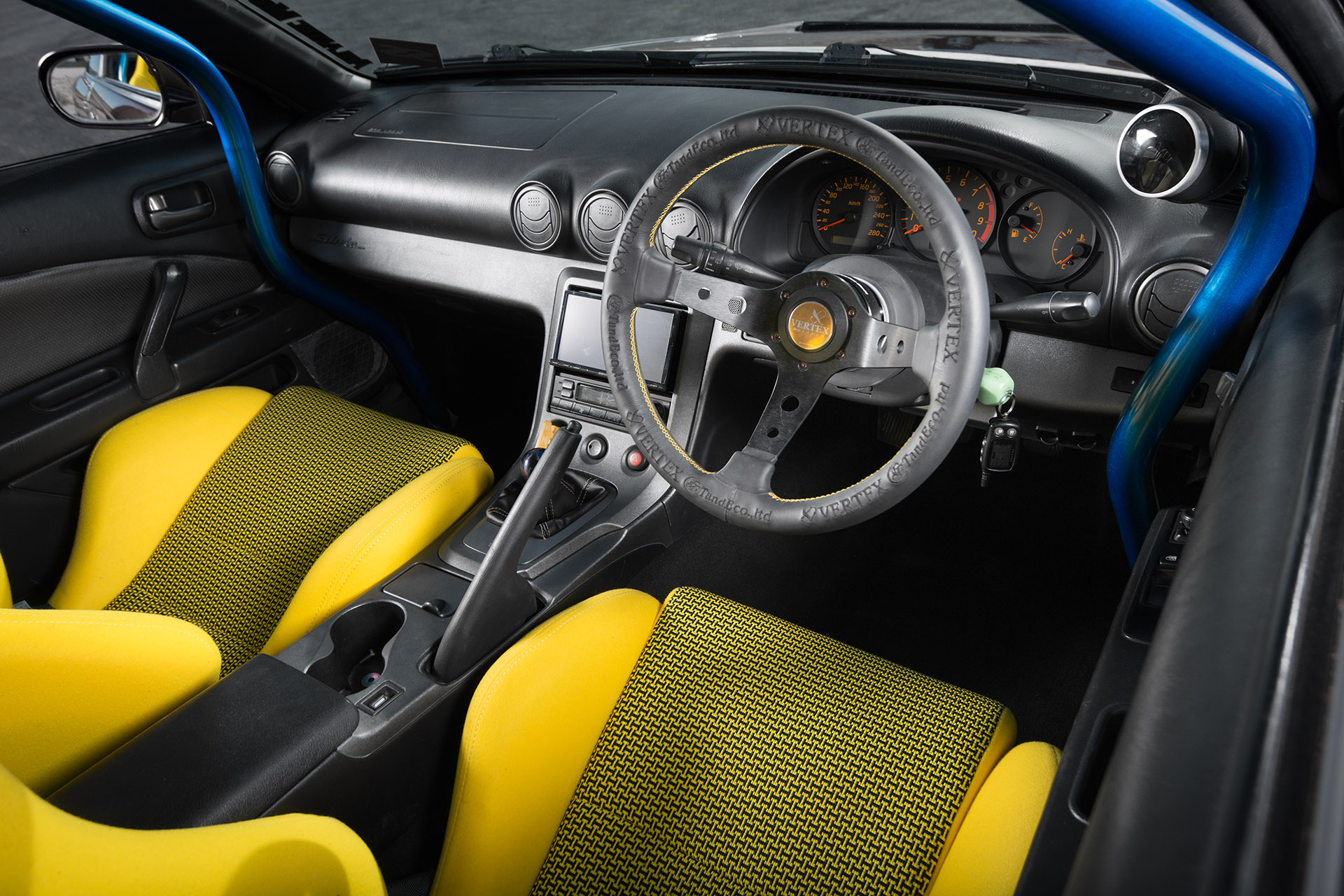 Nissan RB26DETT swapped Midnight Purple III S15 Silvia Super Street magazine interior yellow seats steering wheel automotive photography