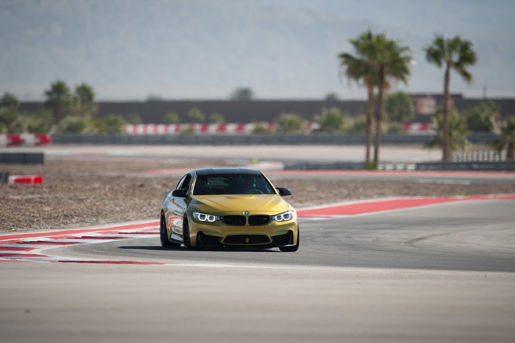 F82 F84 gold BMW M4 competing in European Car magazine Tuner GP at Thermal Club automotive photography