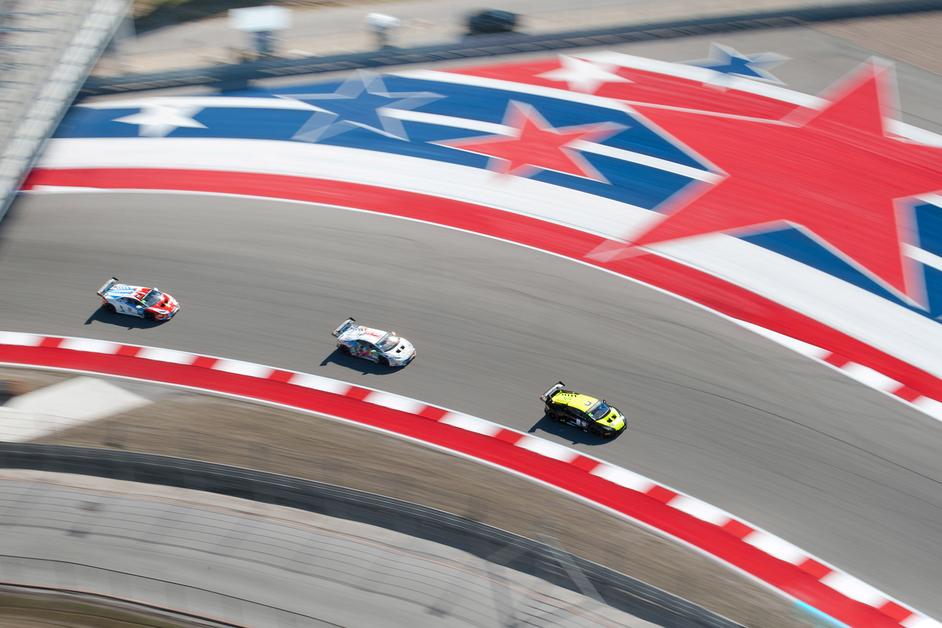 luke Munnell Motorsports photography IMSA COTA Lamborghini Super Trofeo overhead pan blur stars and stripes
