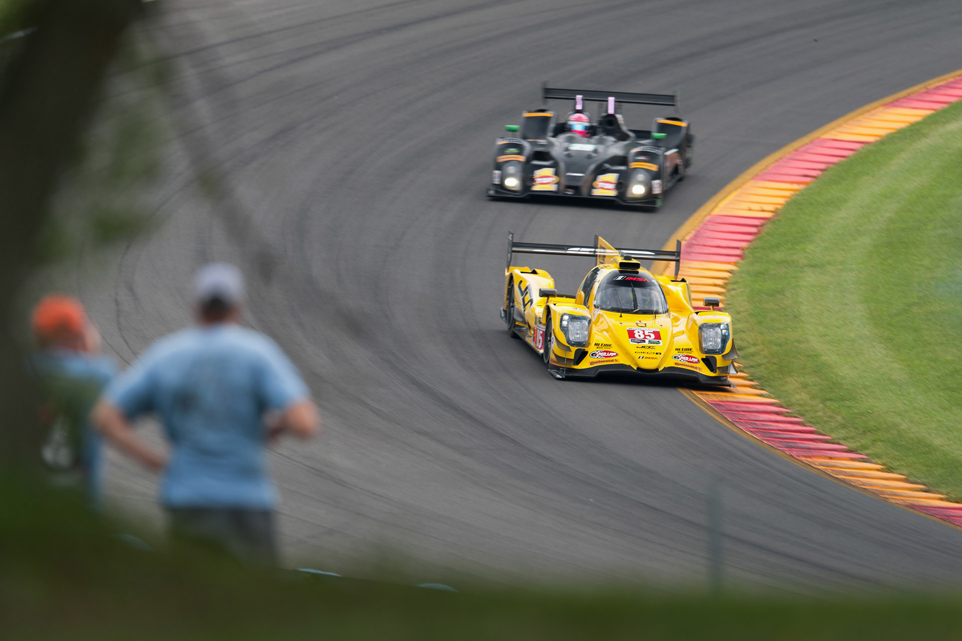 luke Munnell motorsports photography IMSA Watkins Glen 85 JDC Miller Motorsports Oreca prototype racing with spectators in foreground watching