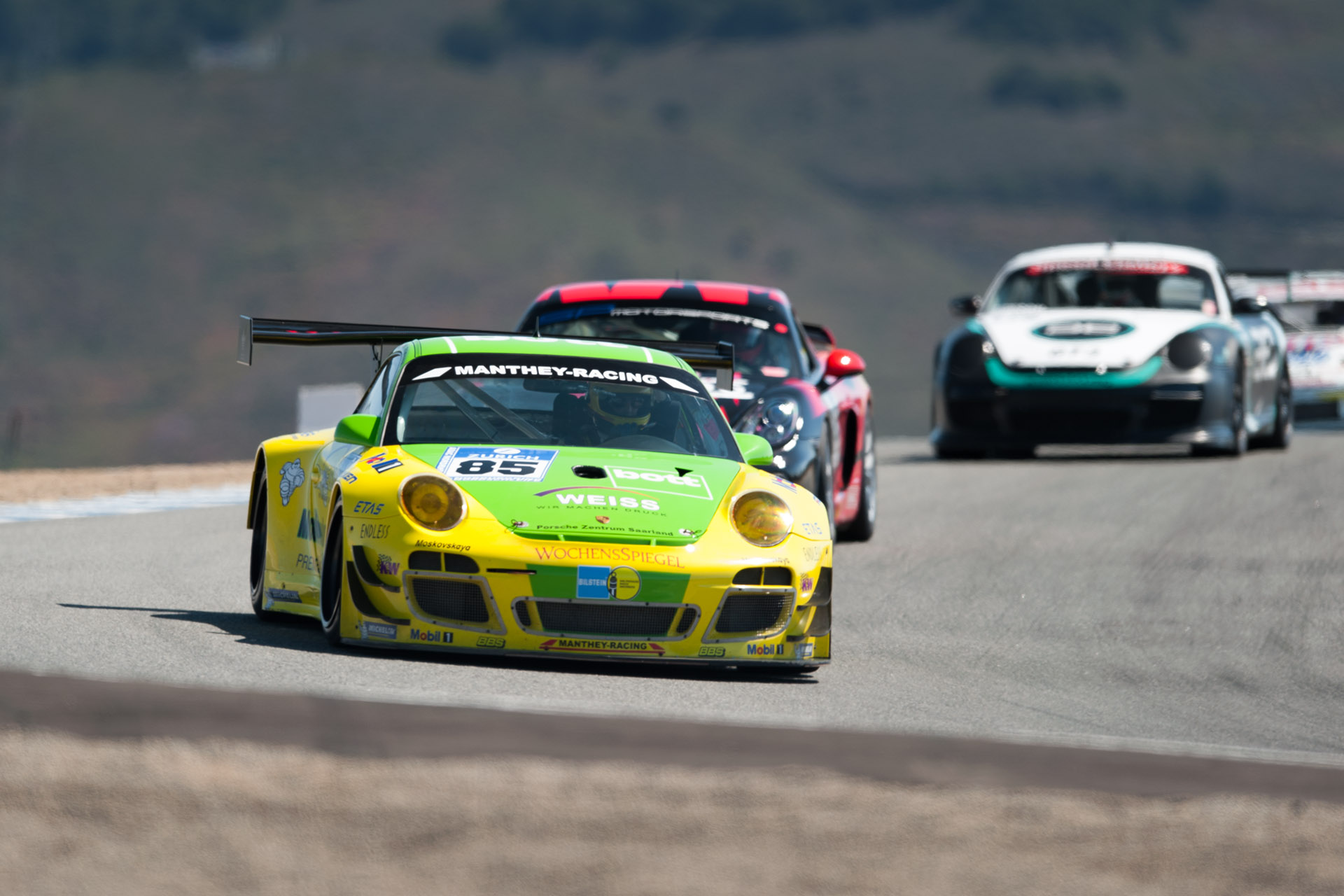 yellow and green luke Munnell motorsports photography Porsche 911 GT3 RSR, Manthey Racing Weiss 85 racing at Laguna Seca in California