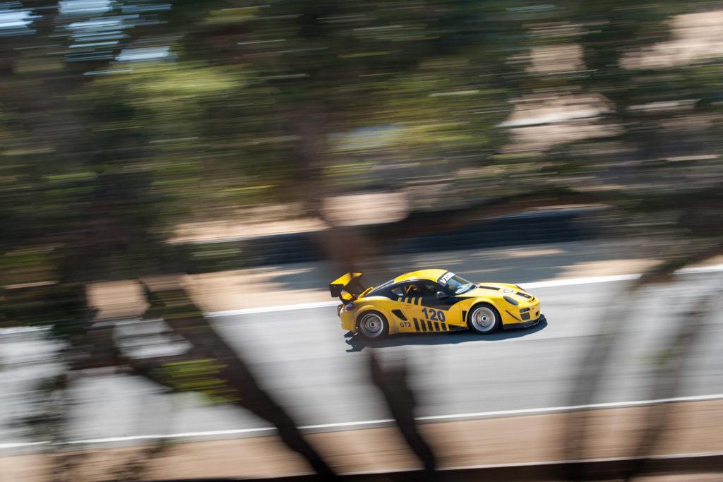 Vision Motorsports 120 Porsche cayman GT2 pan blur at Mazda Raceway Laguna Seca motorsports photography