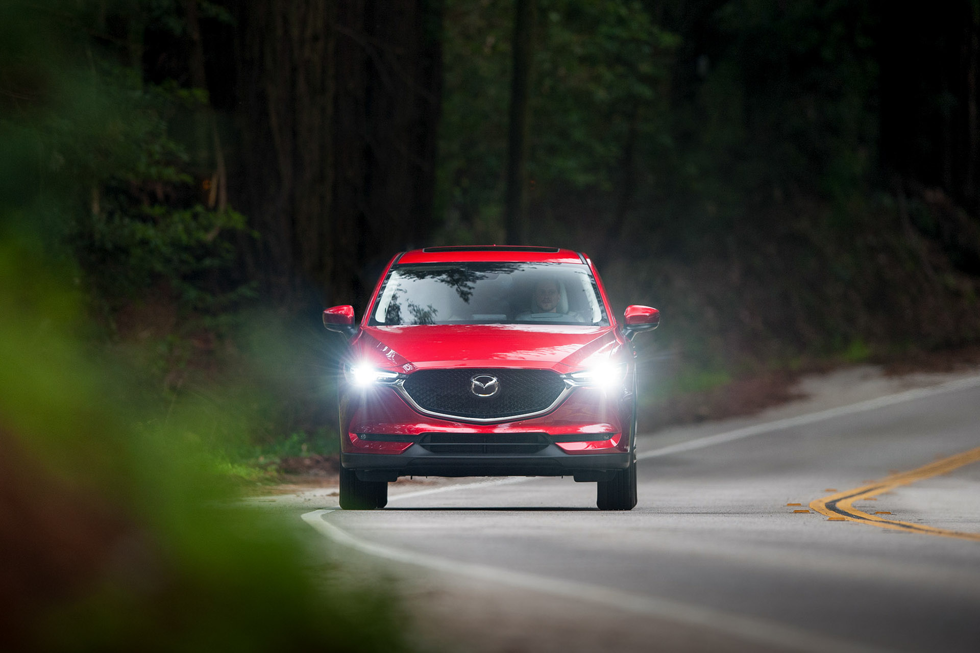 Luke Munnell automotive photography Soul Red Mazda CX-5 front driving headlights on