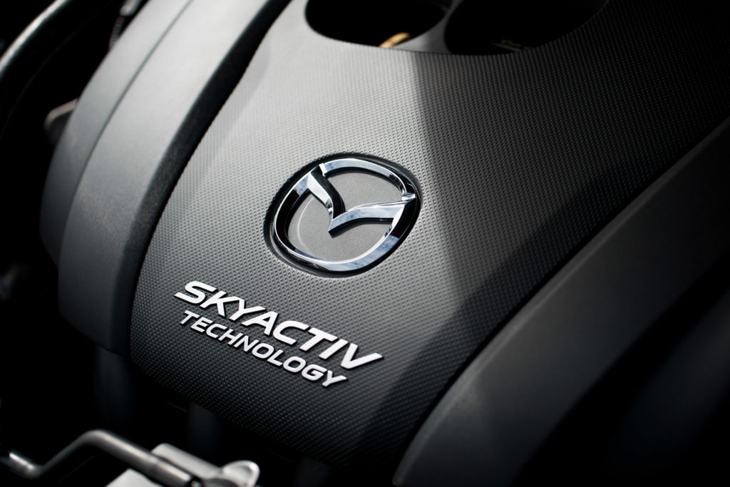 Soul Red 2018 Mazda CX-5 SKYACTIV-G engine cover closeup detail automotive photography