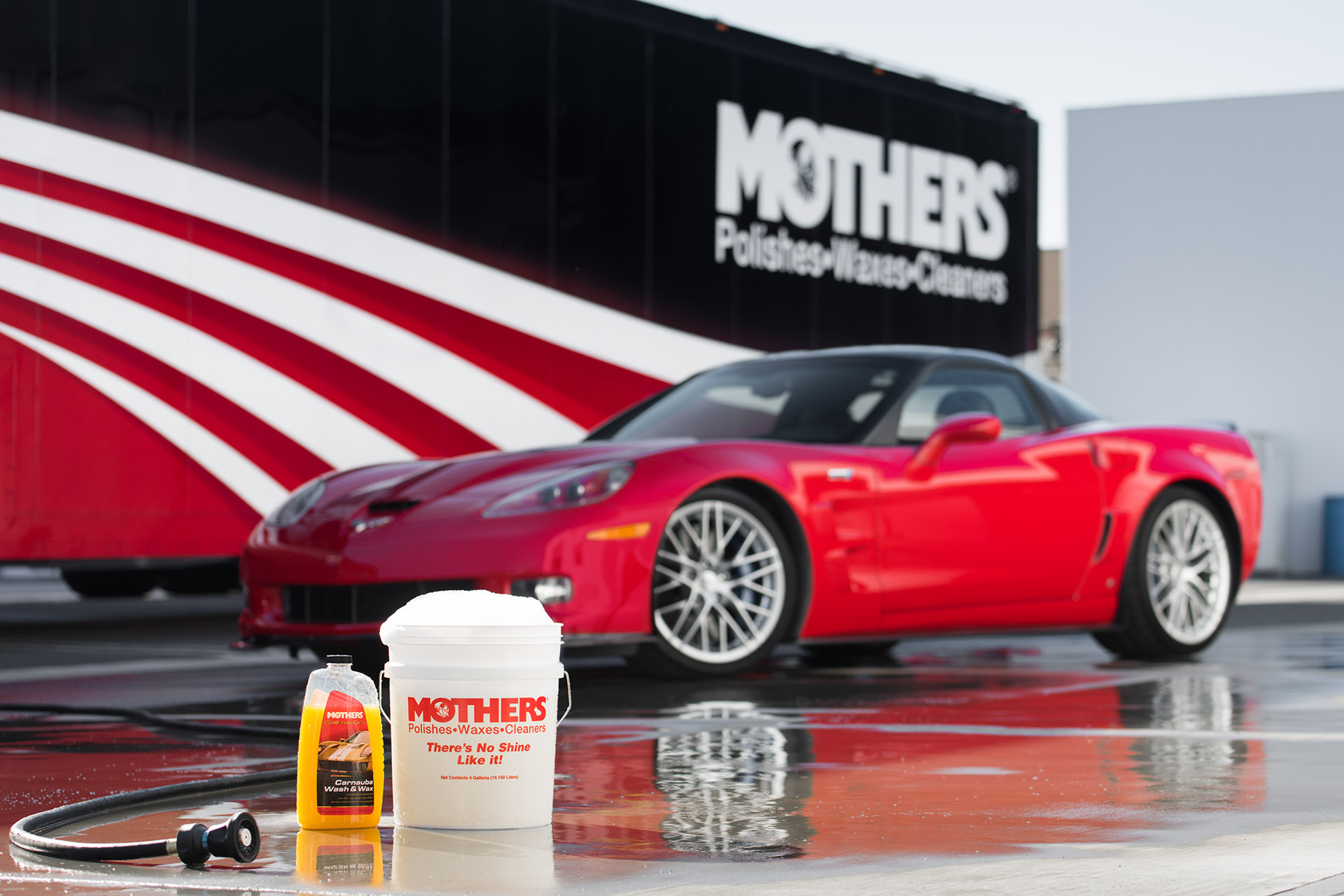 Luke Munnell automotive photography Mother's Detail Guide Chevy Corvette with Mother's car wash bucket and hose