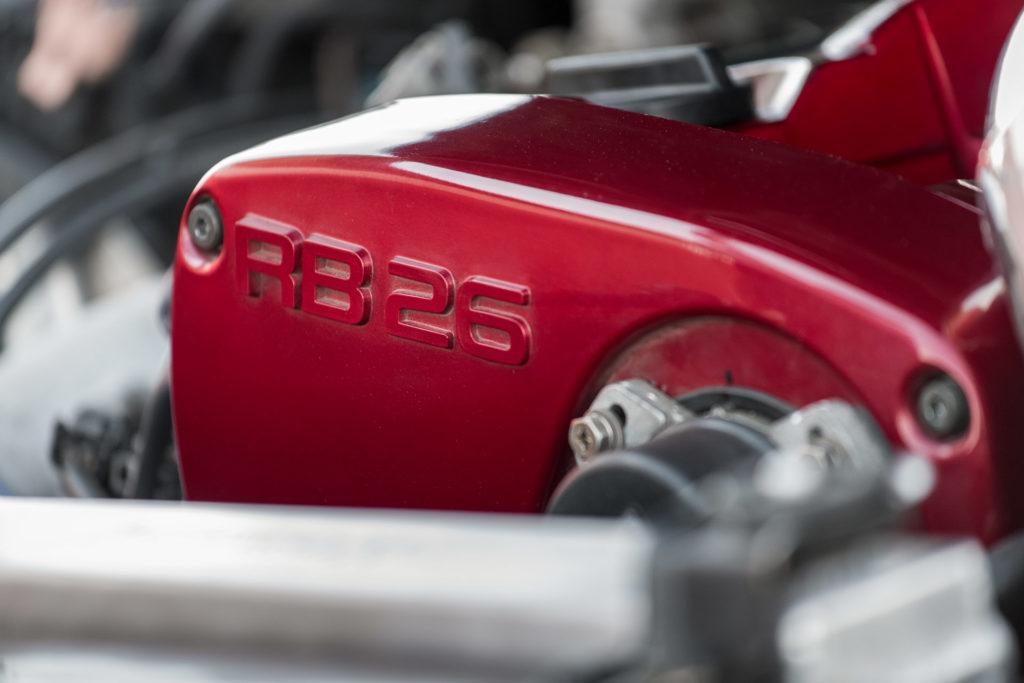 R34 Nissan Skyline GT-R RB26DETT engine red valve cover in Super Street magazine
