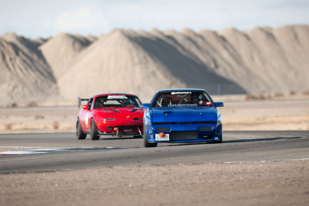 Super Street magazine Odd Swaps Challenge 2JZGTE blue Mitsubishi Starion J30 V6 red NA6 Mazda Miata racing at Buttonwillow raceway