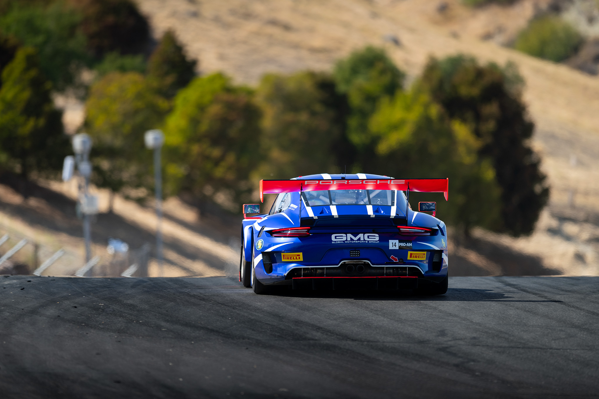 SRO World Challenge GMG Racing Porsche 911 GT3 R with driver James Sofranas, motorsports photography by Luke Munnell