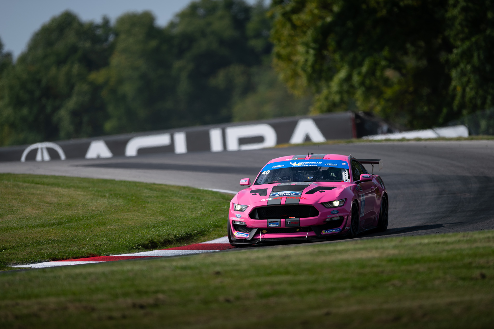 Chad McCumbee driving the PF Racing Ford Mustang GT4 at IMSA Mid Ohio 2020 motorsports photography by Luke Munnell
