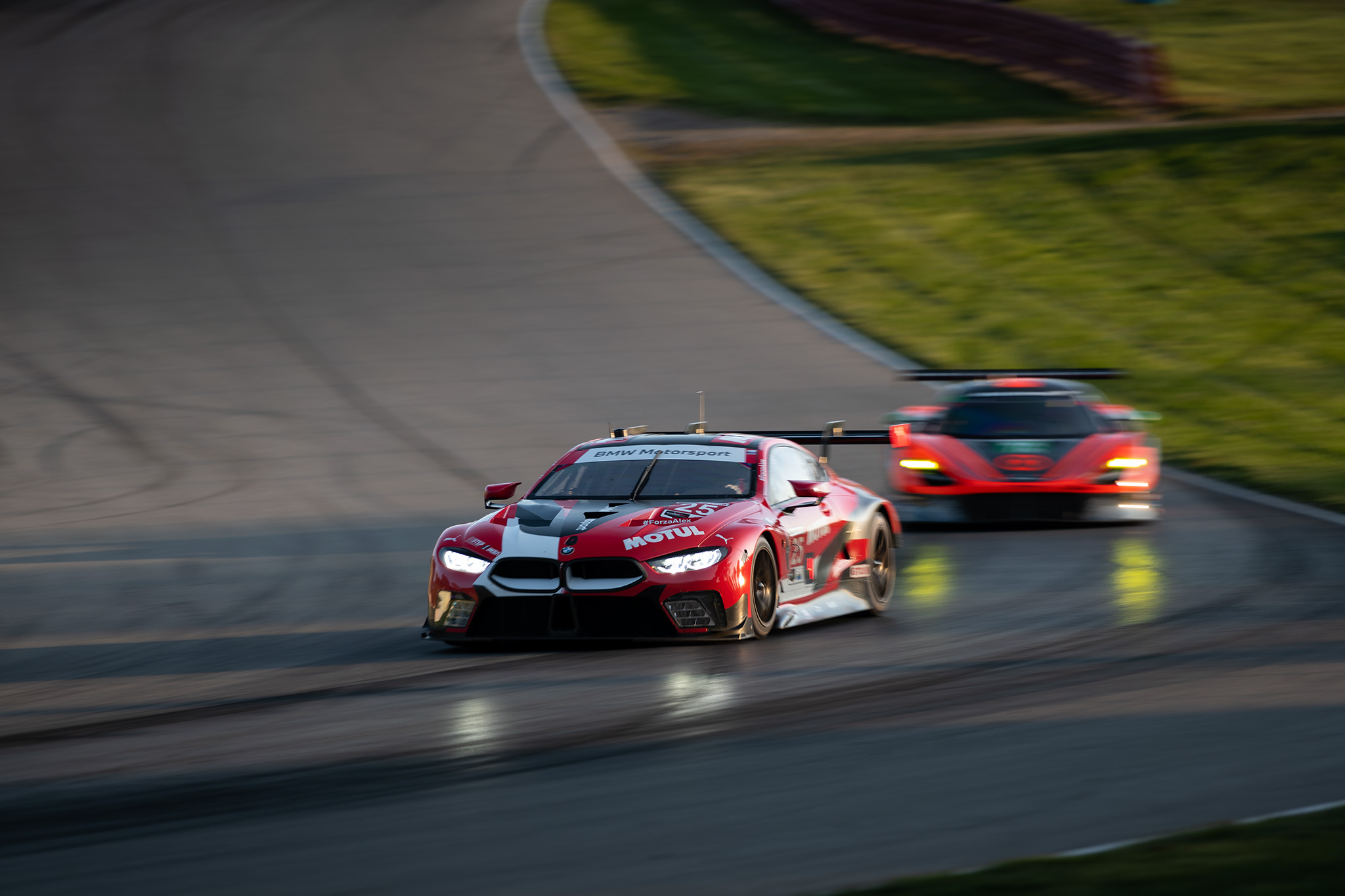 Connor De Phillippi bringing the BMW Team RLL M8 GTE through Madness at IMSA Mid Ohio 2020 motorsports photography by Luke Munnell