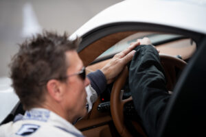 Scott Pruett giving instruction to a guest celebrity driver during the Lexus LC 500 0 to 60 campaign at Auto Club Speedway Fontana, motorsports photography by Luke Munnell