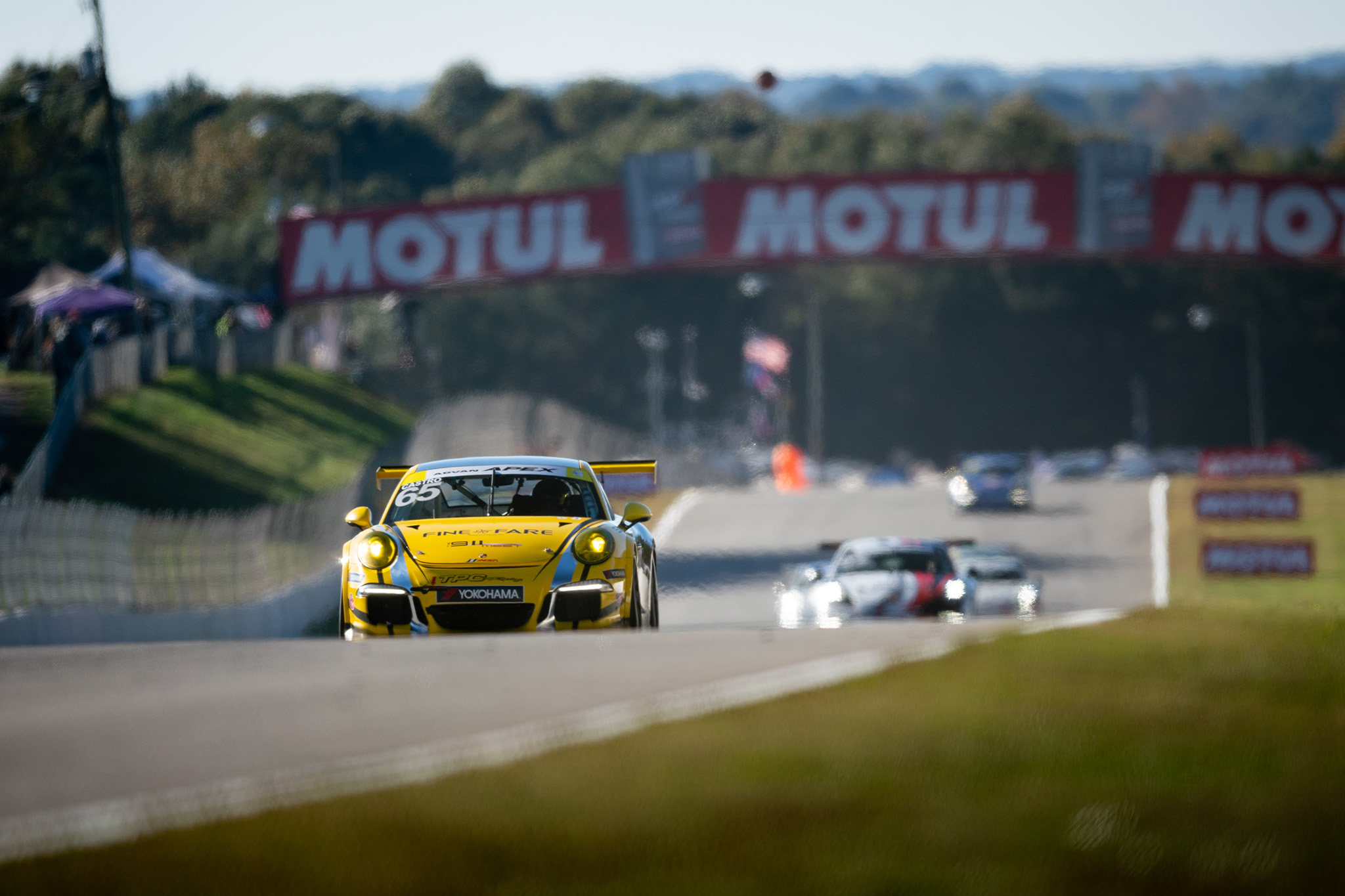 Efrin Castro and the TPC Racing Porsche GT3 Cup Challenge car at IMSA Petit Le Mans at Road Atlanta, motorsports photography by Luke Munnell