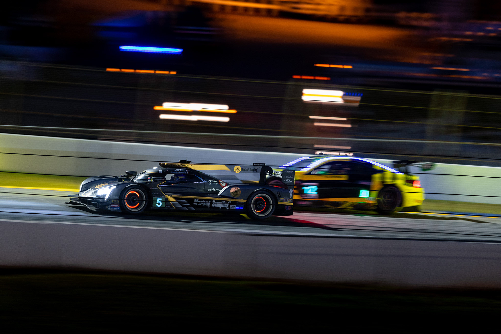 Sebastien Bourdais and the JDC Miller Motorsports Cadillac DPi-V.R cut through the night during the IMSA Petit Le Mans at Road Atlanta, motorsports photography by Luke Munnell