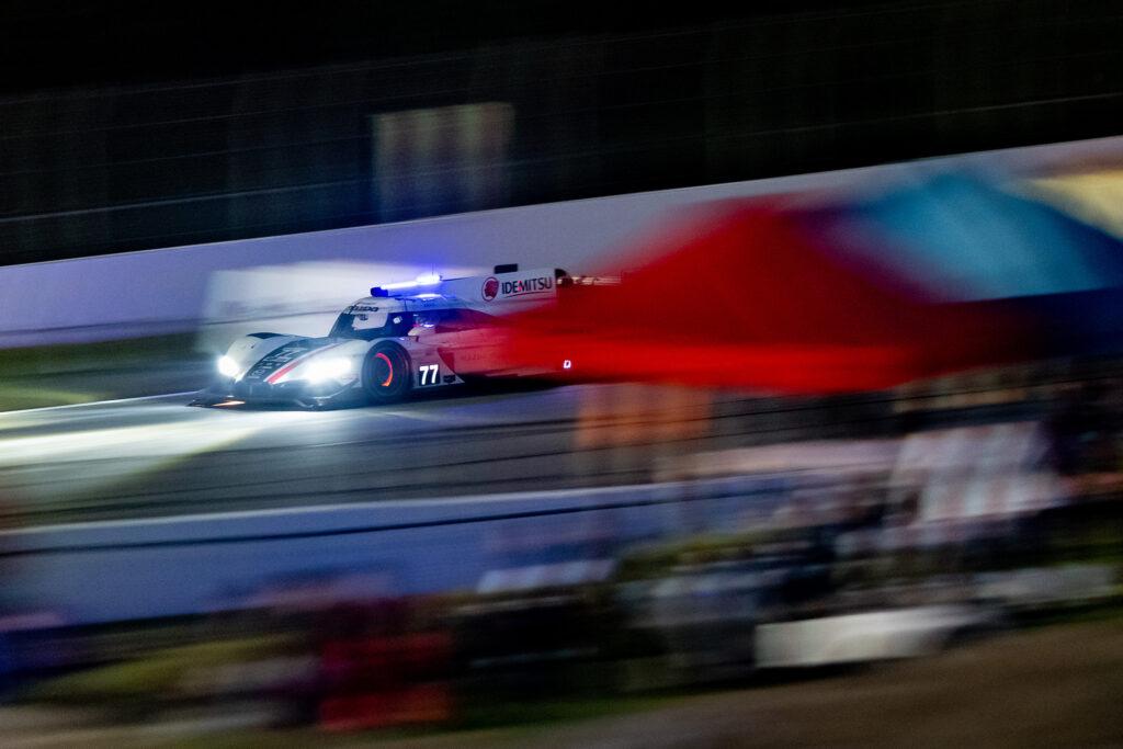 Oliver Jarvis and the Mazda Motorsports no. 77 DPi, braking hard with glowing rotors at night during the IMSA Petit Le Mans at Road Atlanta, motorsports photography by Luke Munnell