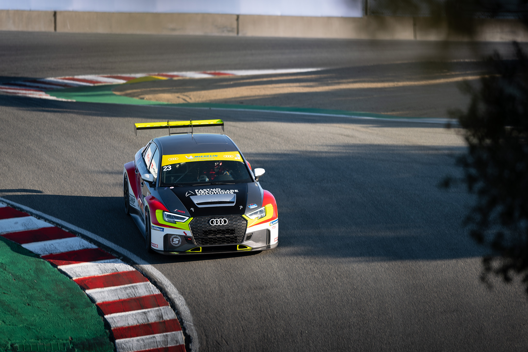 Driver Max Faulkner and the FastMD Audi RS3 LMS TCR barreling down the Corkscrew at IMSA Laguna Seca, motorsports photography by Luke Munnell