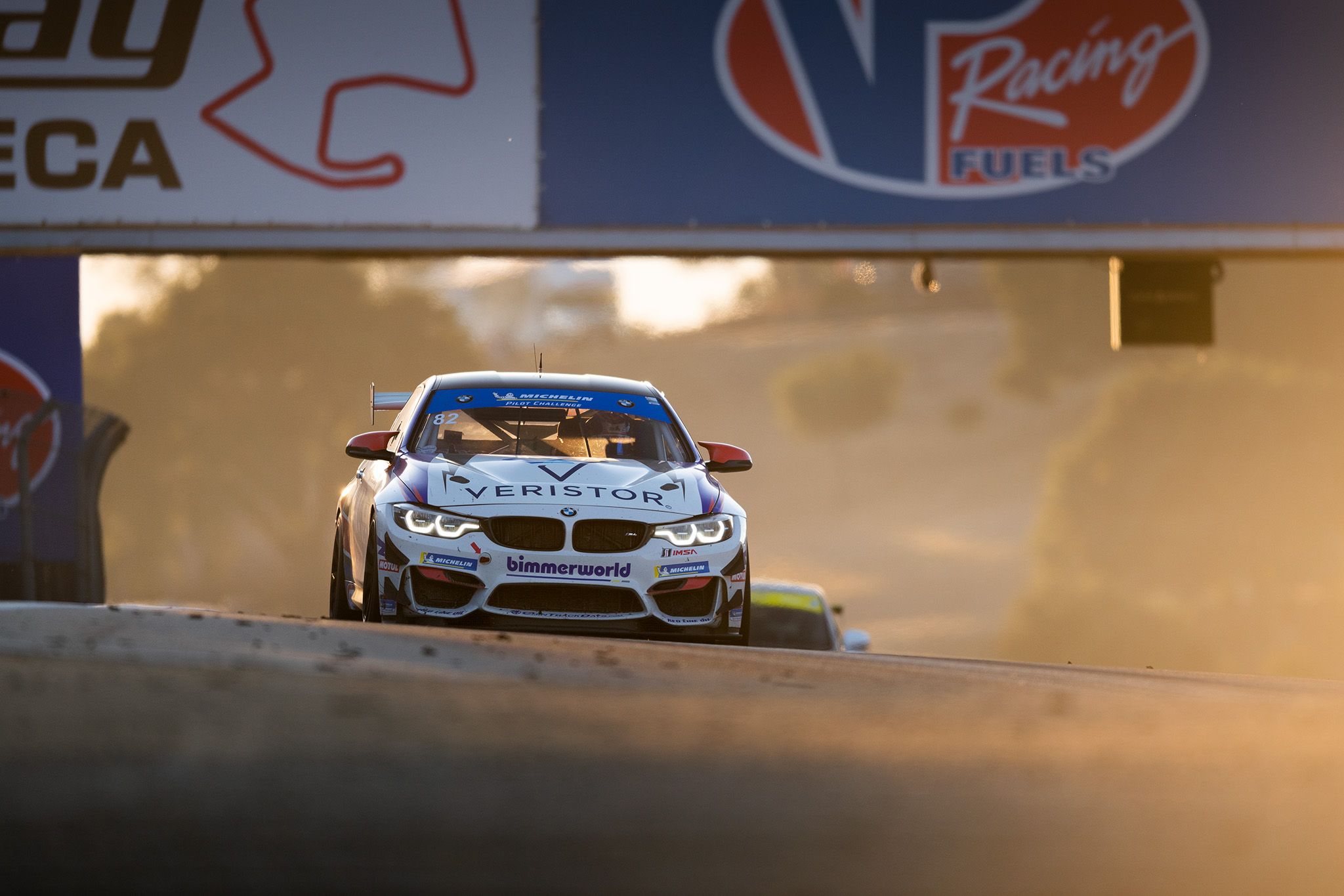 James Clay and the Bimmerworld BMW M4 GT4, cresting against the setting sun at Laguna Seca, photography by Luke Munnell