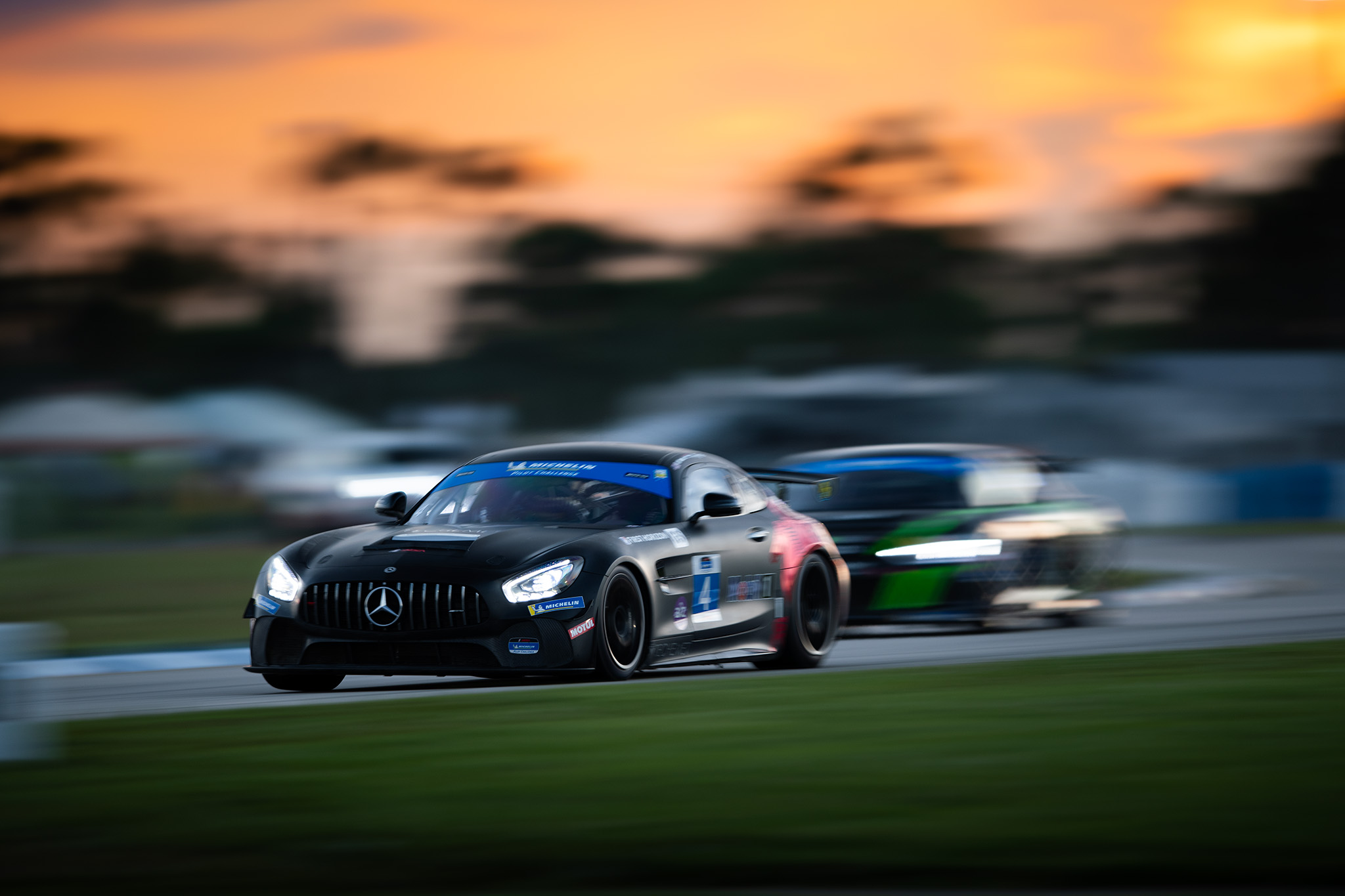 Russell Ward, charging into the dusk in Winward Racing's no 4 Mercedes-AMG GT GT4 at Sebring, photography by Luke Munnell