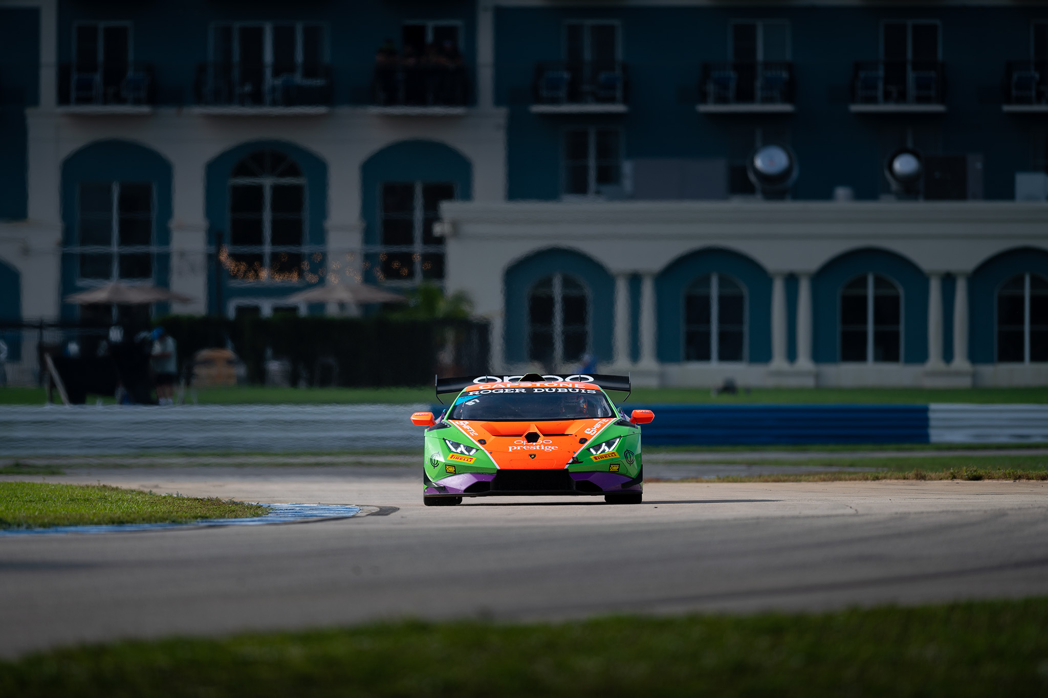 Sydney McKee and the Prestige Performance Lamborghini Huracan Super Trofeo set against the Seven Sebring Racing Hotel, motorsports photography by Luke Munnell