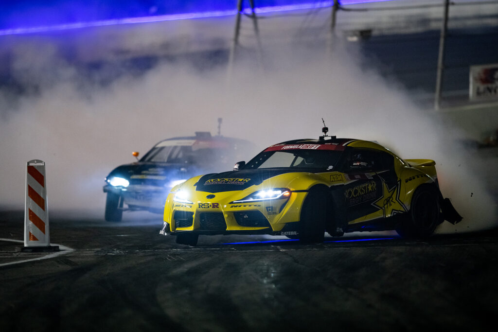Fredric Aasbo and his Papadakis Racing Toyota GR Supra, drifting en route to victory during Round 7 of 8 of Formulad Irwindale finals, motorsports photography by Luke Munnell
