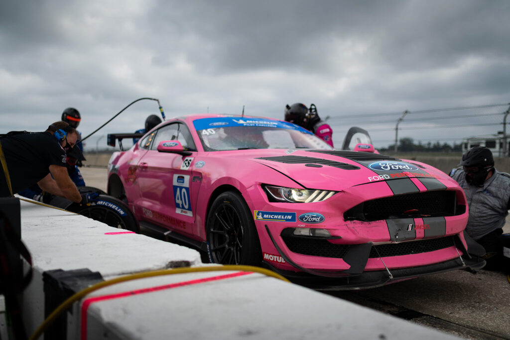 PF Racing pit crew in action at the 2020 IMSA 12 Hours of Sebring, motorsports photography by Luke Munnell