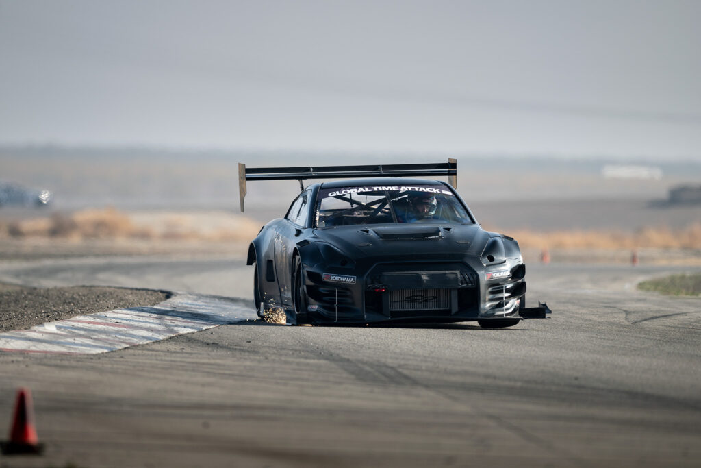 David Haagsma and the Unlimited AWD class record-setting Will Wattanawongkiri / H&M Motorsports Nissan GT-R throwing sparks at Global Time Attack finals motorsports photography by Luke Munnell