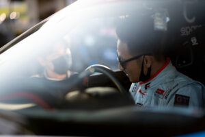 Ken Gushi, having a chat with friend and rival Daijiro Yoshihara during Formula Drift Irwindale finals, motorsports photography by Luke Munnell